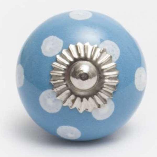 Blauer Keramikknopf mit weißen Punkten